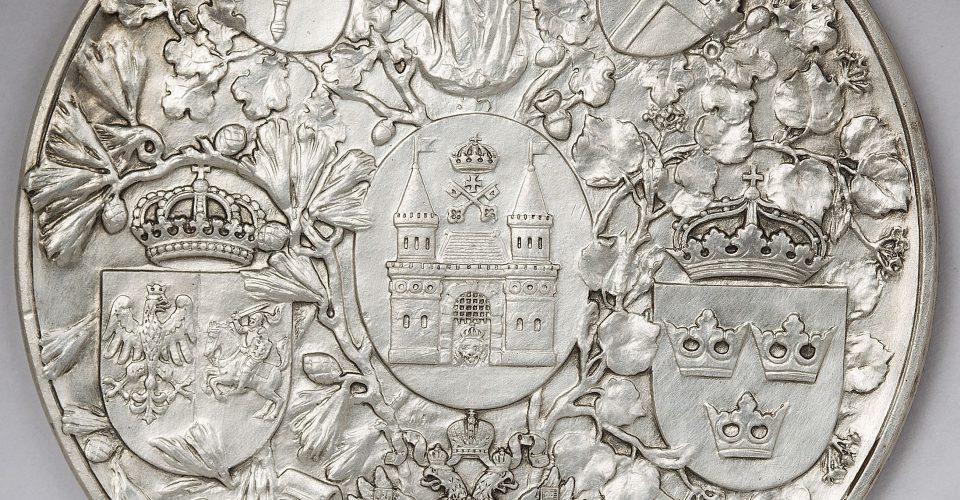 Rīgas 700 gadu jubilejas medaļa. Berlīne, 1901. g. Mākslinieks B. Kruze, skices idejas autors A. Buhholcs, spiedņus griezis M. Hāzerots. Sudrabs. Reverss.