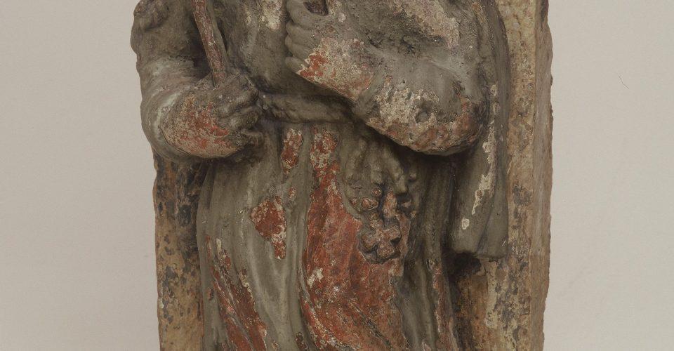 Mūks ar pātagu, 16.gs. Pēc katoļu mūku padzīšanas skulptūra tika novietota virs Bīskapa vārtiem.